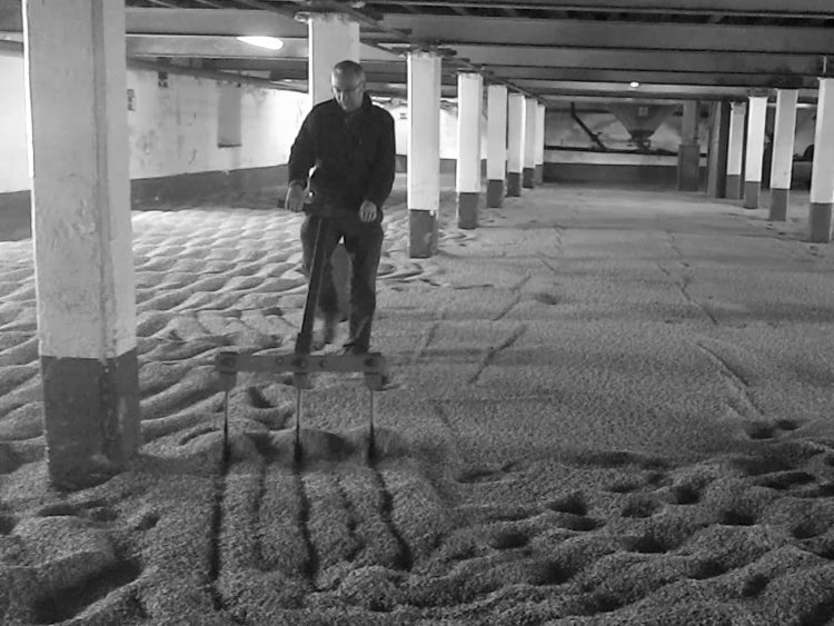 Paul Quin raking malt at Laphroaig Distillery, Islay